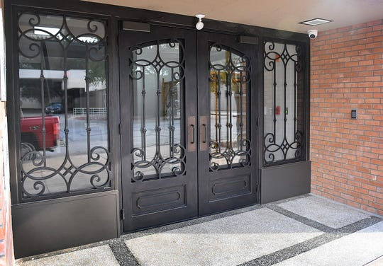 Large, decorative entry doors are featured at the front of the Brown Building which has been recently renovated into the 9th Street Lofts on the second floor.
