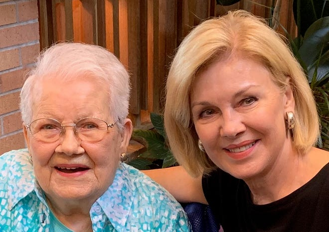 Wichitan Johnelle Donnell, right, helped organize a birthday party for her mother, Mary Matz, right, who turned 98. Friends and family told stories of love often told at a funeral when the honoree isn't there to hear them.