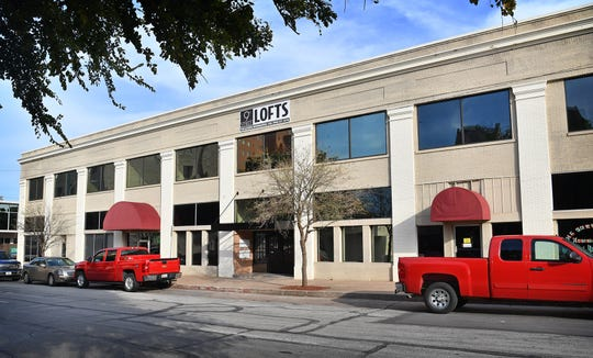 The Brown Building, at the corner of Ninth Street and Lamar, has been recently converted to loft-style apartments with retail businesses on the first floor. City council will consider approval of an expenditure from the 4B Board for this project.