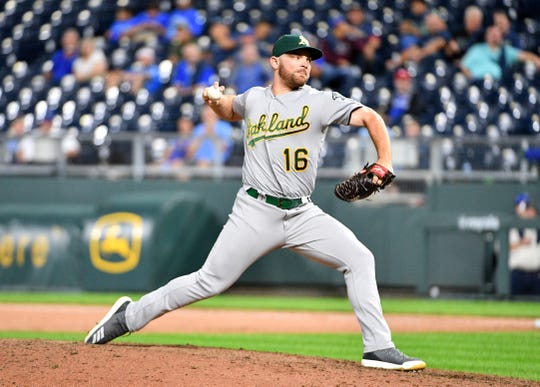 Oakland Athletics relief pitcher Liam Hendriks (16) delivers a pitch in the ninth inning against the Kansas City Royals at Kauffman Stadium.