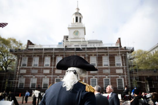 An actor portrays George Washington in front of Independence Hall in Philadelphia in 2017.