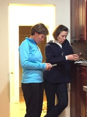 'Always on Duty' (affectionately called by the family) is a photo of Army Maj. Gen. Maria Barrett and her Sister, Army Brig. Gen. Paula Lodi, checking their Smartphones the night before the Army Navy football game in Baltimore after Lodi and family drove up from Fort Bragg, N.C. in the fall of 2016. Interesting fact is the Army Navy game was one of the few times played in Baltimore and Army defeated Navy in the final six minutes with a touchdown, ending Navy's 14-year win streak.