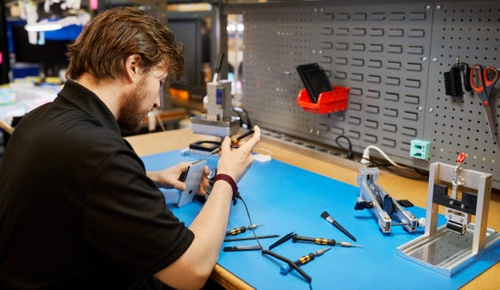 An independent technician can use genuine Apple parts and tools to fix a broken iPhone.