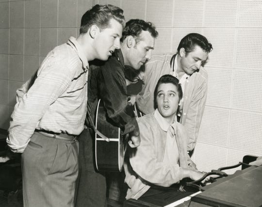 """An archival photo of Jerry Lee Lewis, Carl Perkins, Elvis Presley, and Johnny Cash at the Sun Records studio in Memphis, 1956 used in Ken Burns' PBS documentary, """"Country Music."""""""