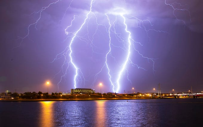 Lightning strikes over Tempe Town Lake,  Tempe, Ariz. during a storm on Aug. 28, 2019.