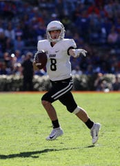 Idaho Vandals wide receiver Mason Petrino (8) runs out of the pocket against the Florida Gators during the second half at Ben Hill Griffin Stadium.