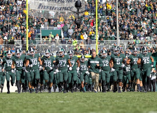 Michigan State Spartans head coach Mark Dantonio leads his team onto the field prior to a game against the Michigan Wolverines at Spartan Stadium n 2018.