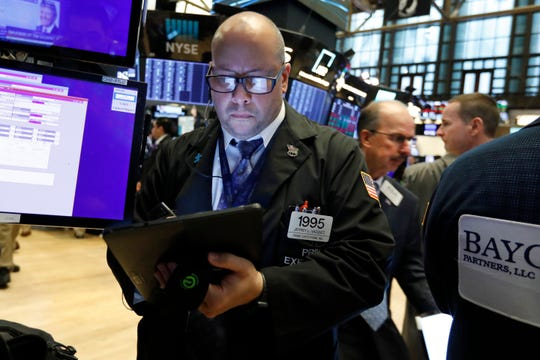 In this Aug. 21, 2019, file photo trader Jeffrey Vazquez works on the floor of the New York Stock Exchange. On Thursday, Aug. 29, stocks are opening higher on Wall Street as investors hope that new talks set for September can result in progress in resolving the U.S.-China trade dispute.
