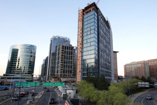 In this Wednesday, May 8, 2019 photo, new buildings form part of the skyline in Boston's Seaport district. On Thursday, Aug. 29, the Commerce Department issues the second estimate of how the U.S. economy performed in the April-June quarter.