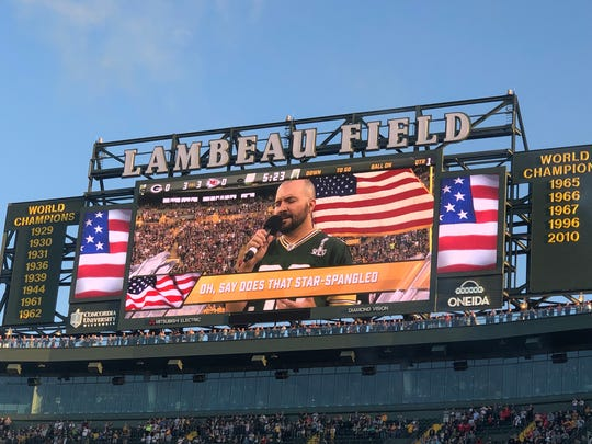 Jacob Fannin sings the national anthem at Lambeau Field Aug. 29, 2019.