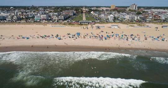 People fill the Ocean Grove beach Friday, August 30, 2019, ahead of the Labor Day weekend.