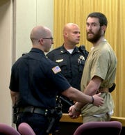 Preston Taylor looks back to his parents before he is taken back to state prison Friday, August 30, 2019,  State Superior Judge Richard English ruled that his 18 year prison term will stand for his role in the murder of Sarah Stern.