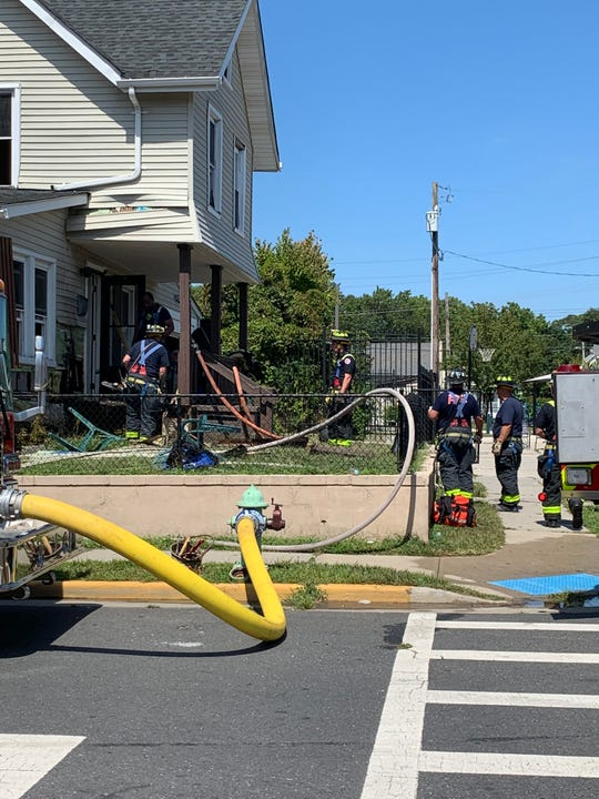 Fire crews battle a two-story house Fire on Atkins Ave in Asbury Park mid-afternoon on Aug. 30, 2019.