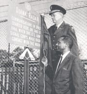 Walter S. McAfee unveils a sign with the then-commander of Fort Monmouth.