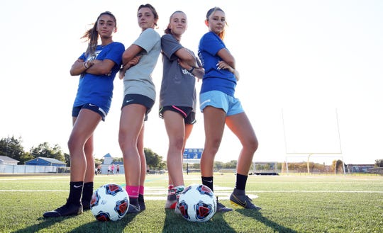 Toms River North captains Amanda Devita, Emily Royson, Paige Farley and Jamie Wychoff pose for a photo in Toms River, Thursday, Aug. 29.