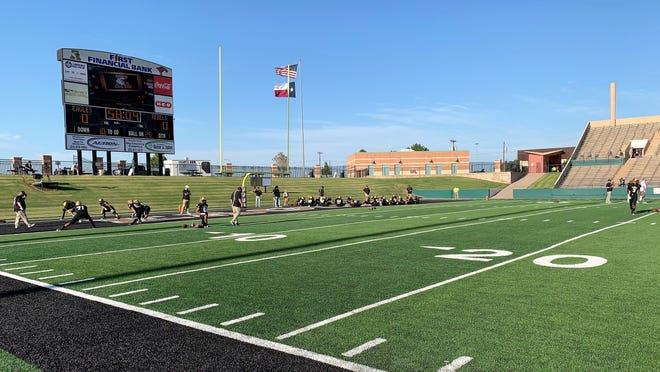 The Abilene High football team warms up before facing Amarillo Tascosa in the 2019 season opener at Shotwell Stadium on Aug. 30.
