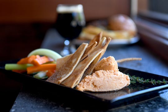The beer cheese spread at The Collaboratory is made with Three Weavers Seafarer Kolsch and served with carrots, celery and flatbread crackers.