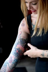 Melissa Gray, owner of Cakes by Gray and RosaBees, shows off her Hawaii-themed sleeve tattoo. The new bar and restaurant is themed around her love of the islands.