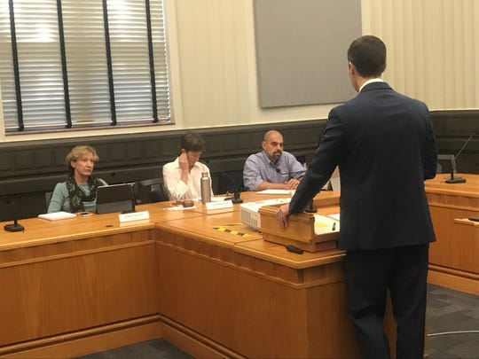 Asheville City Attorney Brad Branham talks to City Council members on the Planning and Economic Development Committee about a potential hotel building moratorium