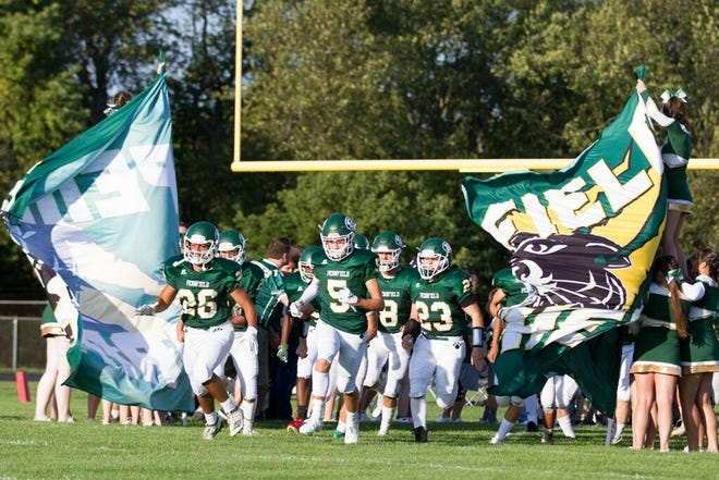 The Pennfield football team takes the field ahead of its season opener against Lake Odessa Lakewood on Thursday, Aug. 29, 2019.
