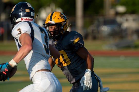 Battle Creek Central senior Markel Main (20) tackles St. Joseph junior Griffin Shinrock (3) on Thursday, Aug. 29, 2019 at Battle Creek Central High School.