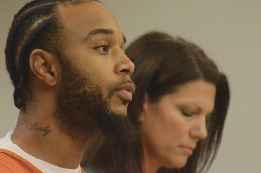 Larry Martin Jr. at his arraignment Friday with Probation Agency Nicole Costa.