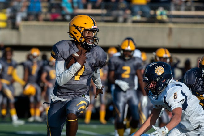 Battle Creek Central senior Theodore Shepherd (1) carries the ball as Battle Creek Central senior Jaquan West (2) preapres to tackle him on Thursday, Aug. 29, 2019 at Battle Creek Central High School.