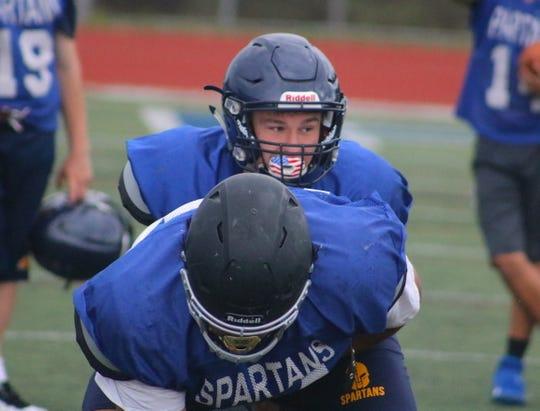 Bainbridge quarterback Alex Ledbetter prepares to take a snap during practice on Thursday. The Spartans open the 2019 season against North Kitsap.
