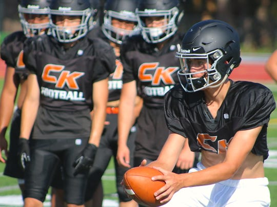 Central Kitsap quarterback Josh Flaugher runs through passing drills at practice Aug. 28.