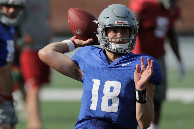 FILE - In this Aug. 16, 2018, file photo, Washington State quarterback Anthony Gordon passes during NCAA college football practice, in Pullman.