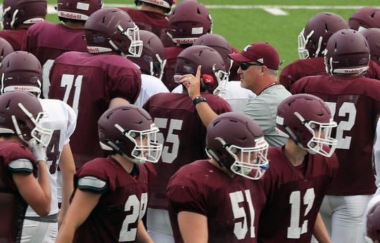 South Kitsap head coach Dan Ericson sends his team to the field after a huddle during practice in Port Orchard on Thursday, August 29, 2019.
