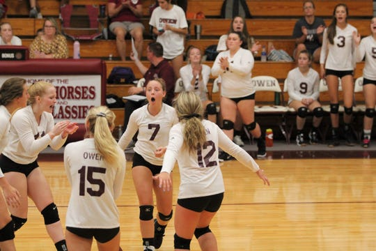 Camillia Harrin (7) celebrates with her teammates after rallying for a point against North Henderson.