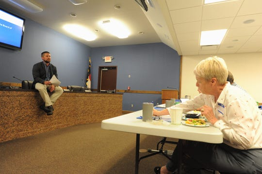 Black Mountain Town Manager Josh Harrold discusses the role and function of local government with participants of the 2019 Black Mountain Citizens Academy.