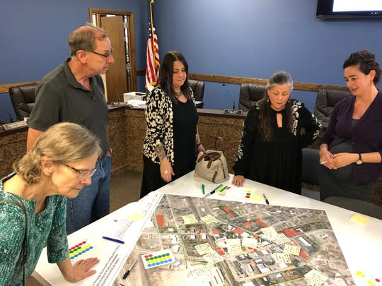 Rachel Bronson, right, of Traffic Planning and Development, Inc. reviews parking data with members of the public and town staff during an Aug. 27 meeting.