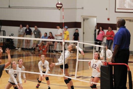 Owen senior Miriam King elevates at the net as the Warlassies fall to 1-3 with a 3-0 loss to North Henderson on Aug. 28.