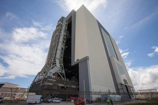 Teams at Kennedy Space Center take precautions to protect spaceflight hardware – in this case, the mobile launcher that will support NASA's Space Launch System rocket – ahead of Hurricane Dorian's impacts to the Space Coast. The tower was moved into the historic Vehicle Assembly Building using a crawler-transporter Friday afternoon.