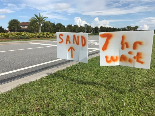 Hundreds brave long lines for sandbags in Viera in advance of Hurricane Dorian.
