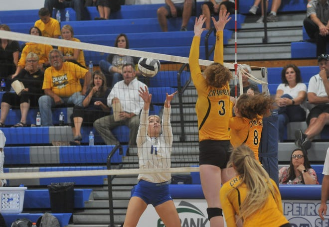 Wynford's Mia Leuthold pushes the ball over the net away from Colonel Crawford's Rylee Ritzhaupt and Alyssa Sallee at the net.
