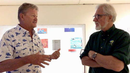 Artists and longtime friends Guy Harvey (left) and Kent Ullberg (right) discuss their shared interest in conservation at the Art Museum of South Texas in Corpus Christi May 24, 2019.
