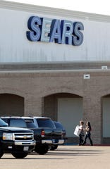 Shoppers walk to their cars Tuesday, Dec. 27, 2011 as they exit the Sears store at Sunrise Mall in Corpus Christi.