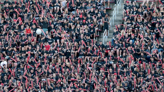 Students file in the student section ahead of the first quarter of an NCAA football game between the Cincinnati Bearcats and UCLA Bruins, Thursday, Aug. 29, 2019, at Nippert Stadium in Cincinnati.