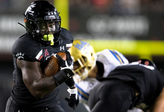 Cincinnati Bearcats running back Michael Warren II (3) scores a touchdown in the second half of the NCAA football game between Cincinnati Bearcats and UCLA Bruins on Thursday, Aug. 29, 2019, at Nippert Stadium in Cincinnati.