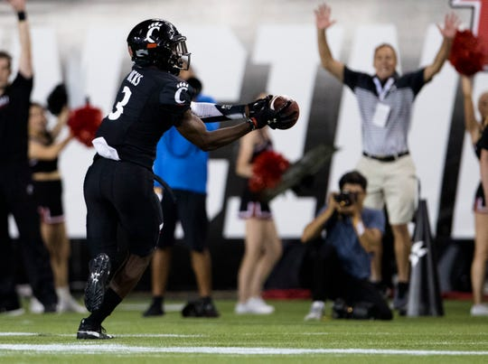 Cincinnati Bearcats safety Ja'von Hicks (3) intercepts a pass in the second half of the NCAA football game between Cincinnati Bearcats and UCLA Bruins on Thursday, Aug. 29, 2019, at Nippert Stadium in Cincinnati.