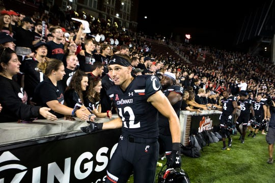 Cincinnati Bearcats wide receiver Alec Pierce (12) celebrates with fans after the NCAA football game between Cincinnati Bearcats and UCLA Bruins on Thursday, Aug. 29, 2019, at Nippert Stadium in Cincinnati. Cincinnati Bearcats defeated UCLA Bruins 24-14.