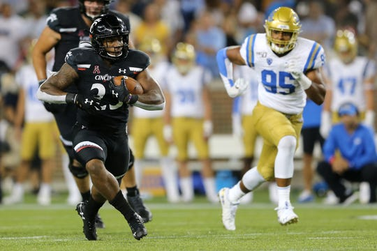 Cincinnati Bearcats running back Gerrid Doaks (23) carries the ball in the third quarter of an NCAA football game against the UCLA Bruins, Thursday, Aug. 29, 2019, at Nippert Stadium in Cincinnati. Cincinnati won 24-14.
