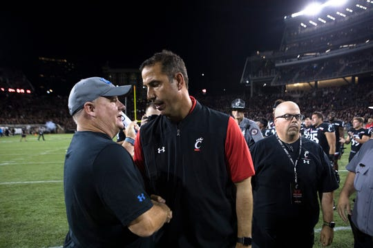 Cincinnati Bearcats head coach Luke Fickell, right, shakes hands with UCLA Bruins head coach Chip Kelly after the NCAA football game between Cincinnati Bearcats and UCLA Bruins on Thursday, Aug. 29, 2019, at Nippert Stadium in Cincinnati. Cincinnati Bearcats defeated UCLA Bruins 24-14.