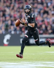Cincinnati Bearcats quarterback Desmond Ridder (9) rolls out of the pocket in the second quarter of an NCAA football game against the UCLA Bruins, Thursday, Aug. 29, 2019, at Nippert Stadium in Cincinnati.