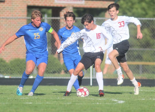 """Holy Cross junior Holden Lipscomb looks for an opening as Newport Central Catholic defeated Holy Cross 1-1 (4-1 in PKs) in the semifinals of the All """"A"""" Classic 9th Region boys soccer tournament August 29, 2019 at St. Henry District High School, Erlanger."""