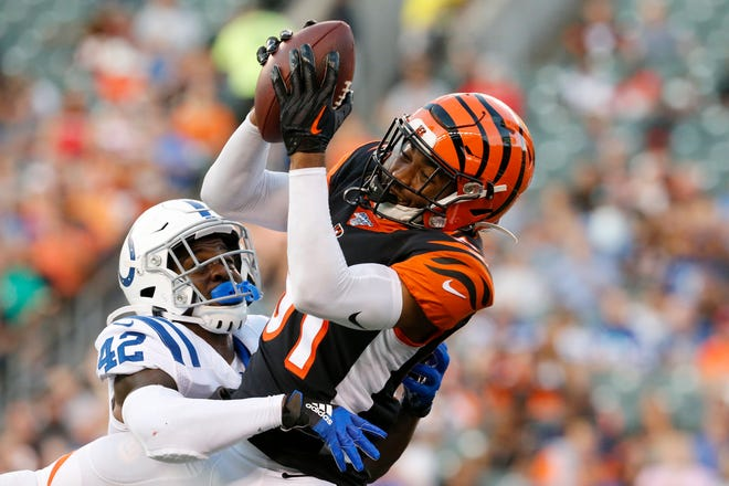 Cincinnati Bengals wide receiver Ventell Bryant (81) pulls in a catch over Indianapolis Colts defensive back Rolan Milligan (42) in the second quarter of the preseason week four game between the Cincinnati Bengals and the Indianapolis Colts at Paul Brown Stadium in downtown Cincinnati on Thursday, Aug. 29, 2019. The Colts led 7-3 at halftime.