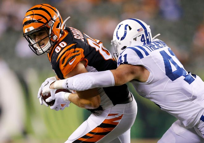 Cincinnati Bengals tight end Mason Schreck (86) makes a catch ahead of Indianapolis Colts safety Jacob Thieneman (41) in the fourth quarter of the preseason week four game between the Cincinnati Bengals and the Indianapolis Colts at Paul Brown Stadium in downtown Cincinnati on Thursday, Aug. 29, 2019. The Bengals fell 13-6 in the final preseason game.